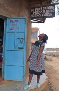 Ann excited at new shop sign, The Kenya Initiative